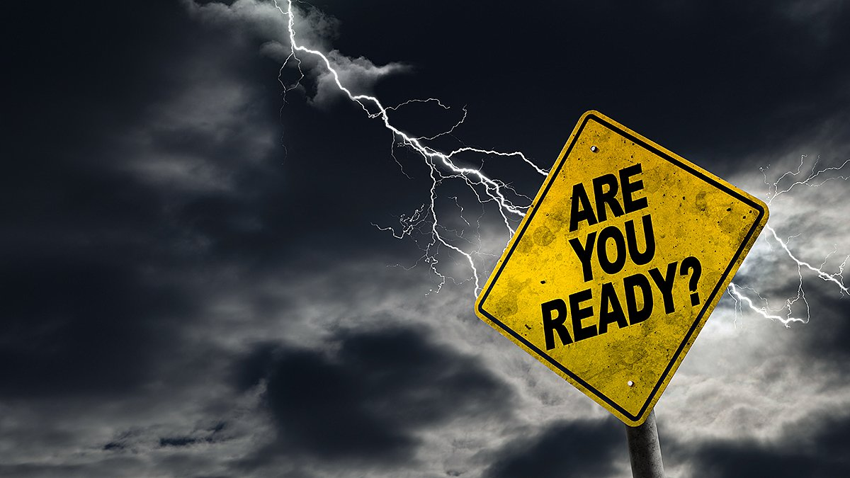 """Are You Ready?"" sign with storm approaching, warning of impending crisis"